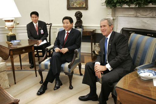 President George W. Bush and President Roh Moo-hyun of the Republic of Korea meet in the Oval Office Friday, June 10, 2005. White House photo by Paul Morse