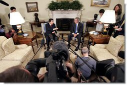 President George W. Bush and South Korean President Roh Moo-hyun talk with the press in the Oval Office Friday, June 10, 2005.  White House photo by Paul Morse