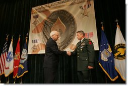Vice President Dick Cheney awards U.S. Army Chief Warrant Officer Four David Smith the Distinguished Flying Cross during the Heroism Awards Ceremony at the Davis Conference Center, MacDill Air Force Base, in Tampa, Fla., Friday, June 10, 2005.  White House photo by David Bohrer