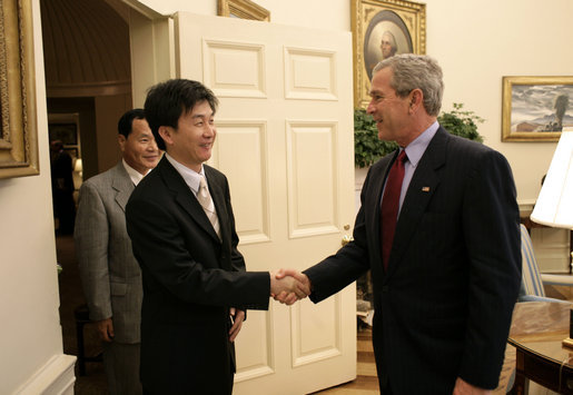 "President George W. Bush welcomes Chol-hwan Kang to the Oval Office Monday, June 13, 2005. Mr. Kang is the author of, ""The Aquariums of Pyongyang: Ten Years in the North Korean Gulag."" Mr. Kang defected from North Korea and now lives in South Korea and works as a journalist. White House photo by Eric Draper"