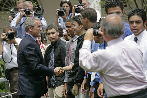 President George W. Bush greets some of the 200 exchange students he addressed in the Rose Garden Monday, June 13, 2005. Living with host families in America for one year, students from the many Muslim countries participate in the State Department program, Partnerships for Learning, Youth Exchange and Study. White House photo by Eric Draper