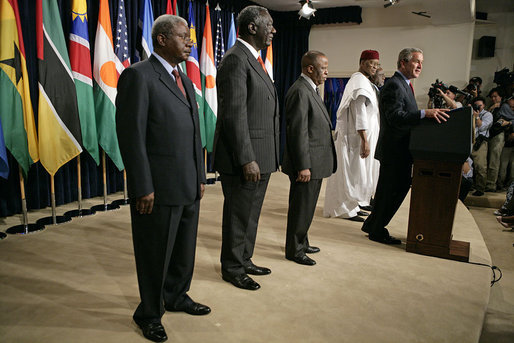 "Standing with the Presidents of Botswana, Ghana, Namibia, Mozambique and Niger, President Bush discussed the African Growth and Opportunity Act, AGOA, in the Dwight D. Eisenhower Executive Office Building Monday, June 13, 2005. ""All of us share a fundamental commitment to advancing democracy and opportunity on the continent of Africa,"" said the President. ""And all of us believe that one of the most effective ways to advance democracy and deliver hope to the people of Africa is through mutually beneficial trade."" White House photo by Eric Draper"