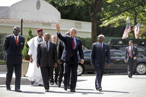 President George W. Bush walks with the Presidents from Botswana, Ghana, Namibia, Mozambique and Niger along West Executive Avenue at the White House Monday, June 13, 2005. President Bush and the African leaders met in the Oval Office before delivering a statement about AGOA to the press in the Dwight D. Eisenhower Executive Office Building. White House photo by Eric Draper