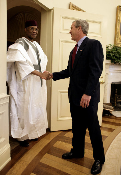 "Meeting with the leaders from Mozambique, Botswana, Niger, Ghana and Namibia, President George W. Bush welcomes President Mamadou Tandja of Niger to the Oval Office Monday, June 13, 2005. The leaders discussed a range of topics, including AGOA. ""All the Presidents gathered here represent countries that have held democratic elections in the last year,"" said President Bush. ""What a strong statement that these leaders have made about democracy and the importance of democracy on the continent of Africa."" White House photo by Eric Draper"