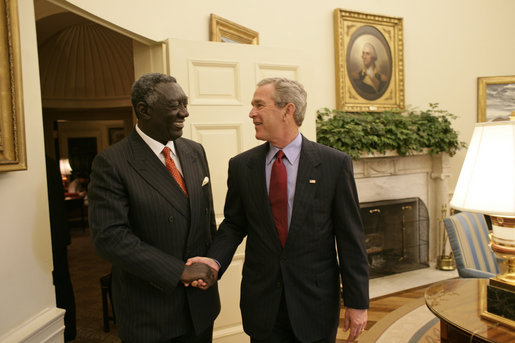 "Meeting with the leaders from Mozambique, Botswana, Niger, Ghana and Namibia, President George W. Bush welcomes President John Kufuor of Ghana to the Oval Office Monday, June 13, 2005. The leaders discussed a range of topics, including AGOA. ""All the Presidents gathered here represent countries that have held democratic elections in the last year,"" said President Bush. ""What a strong statement that these leaders have made about democracy and the importance of democracy on the continent of Africa."" White House photo by Eric Draper"