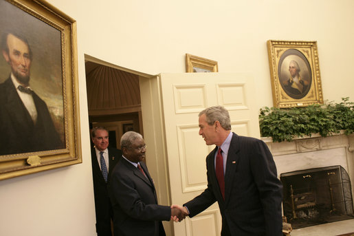 "Meeting with the leaders from Mozambique, Botswana, Niger, Ghana and Namibia, President George W. Bush welcomes President Armando Guebuza of Mozambique to the Oval Office Monday, June 13, 2005. The leaders discussed a range of topics, including AGOA. ""All the Presidents gathered here represent countries that have held democratic elections in the last year,"" said President Bush. ""What a strong statement that these leaders have made about democracy and the importance of democracy on the continent of Africa."" White House photo by Eric Draper"