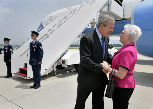 President George W. Bush talks with Freedom Corps Greeter Mickey Peters at University Park Airport in Pennsylvania Tuesday, June 14, 2005. Mickey has been a volunteer with the Centre County Cooperative Extension 4-H program for more than 40 years. White House photo by Eric Draper
