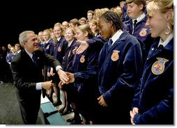 "President George W. Bush greets members of the Pennsylvania FFA at their annual convention at Pennsylvania State University Tuesday, June 14, 2004. ""I appreciate the fact that the Pennsylvania FFA has made a table for the Crawford, Texas FFA. I'm looking forward to telling the folks there at Crawford how decent the good folks here are in Pennsylvania, said President Bush."" White House photo by Eric Draper"