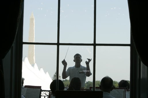 "Lt. Col. Michael J. Colburn, USMC, conducts ""The President's Own"" United States Marine Band during the Congressional Picnic on the South Lawn Wednesday, June 15, 2005. White House photo by Paul Morse"