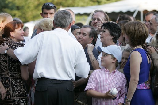 President George W. Bush meets with guests during the Congressional Picnic on the South Lawn Wednesday, June 15, 2005. White House photo by Paul Morse