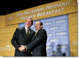 President George W. Bush is thanked by Reverend Danny Cortes after speaking at the National Hispanic Prayer Breakfast at the Andrew Mellon Auditorium in Washington, D.C., Thursday, June 16, 2005.  White House photo by Eric Draper