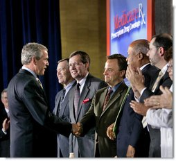President George W. Bush greets Mark McClellan, Centers for Medicare and Medicaid Services Administrator, after speaking on Medicare at the U.S. Department of Health and Human Services Thursday, June 16, 2005. White House photo by Eric Draper