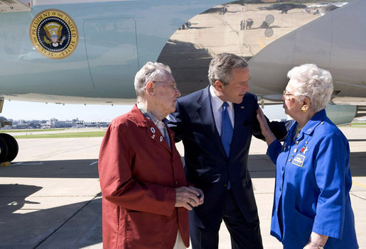 President George W. Bush talks with John and Agnes Jurek in front of Air Force One in Minneapolis Friday, June 17, 2005. The Jureks are volunteers with the Retired and Senior Volunteer Program (RSVP). They each have logged more than 4,000 hours since volunteering at the Veterans Affairs Medical Center in Minneapolis 16 years ago. White House photo by Eric Draper