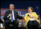 President George W. Bush and Dorothy Bourgeois share a light moment together on stage Friday, June 17, 2005, during a Conversation on Medicare in Maple Grove Minn. White House photo by Eric Draper