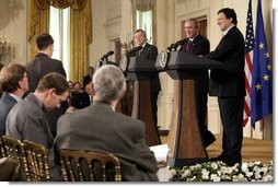 President George W. Bush, European Union President Jean-Claude Juncker, left, and European Commission President Jose Manuel Barroso smile as they answer a reporter's question Monday, June 20, 2005, during a press availability in the East Room of the White House.  White House photo by Eric Draper