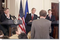 President George W. Bush is flanked by European Union President Jean-Claude Juncker, left, and European Commission President Jose Manuel Barroso as they participate in a news conference in the East Room Monday, June 20, 2005.  White House photo by Paul Morse