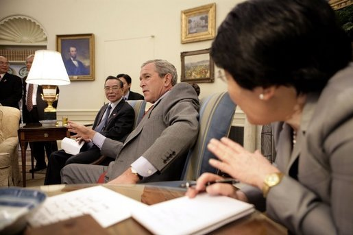 "Meeting on the 10th anniversary of the establishment of diplomatic relations between the United States and Vietnam, President George W. Bush met with Prime Minister Phan Van Khai of Vietnam in the Oval Office Tuesday, June 21, 2005. ""At the invitation of President George W. Bush, it gives me the great pleasure and honor as the first Vietnamese Prime Minister to pay an official visit to the United States,"" said the Prime Minister to the press. White House photo by Eric Draper"