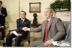 "President George W. Bush and Prime Minister Phan Van Khai of Vietnam deliver statements to the media in the Oval Office Tuesday, June 21, 2005. ""We discussed our economic relations. And I noted that the Vietnamese economy is growing quite substantially. We talked about our desire for Vietnam to join the WTO,"" said the President. ""We talked about security issues and a mutual desire to coordinate in the war on terror.""  White House photo by Eric Draper"