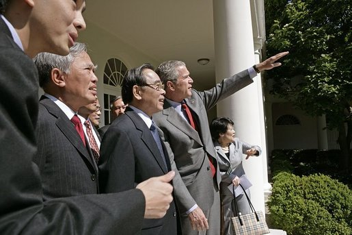 After meeting in the Oval Office, President George W. Bush shows Vietnamese Prime Minister Phan Van Khai and his delegation the Rose Garden during their visit to the White House Tuesday, June 21, 2005. It is the first visit by a Prime Minister from Vietnam in more than 30 years. White House photo by Eric Draper