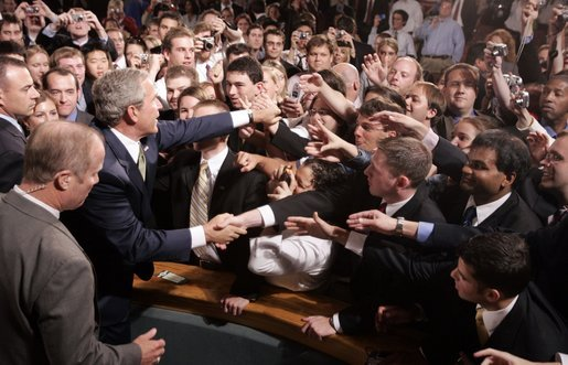 President George W. Bush reaches out to the crowd Thursday, June 23, 2005, after a Conversation on Strengthening Social Security at Montgomery Blair High School in Silver Spring, Maryland. White House photo by Paul Morse