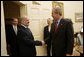 President George W. Bush shakes the hand of Iraq's Prime Minister Ibrahim Jaafari as he and U.S. Ambassador Donald Ensenat welcome the Prime Minister to the Oval Office Friday, June 24, 2005. Interpreter Gamal Helal stands in background. White House photo by Eric Draper