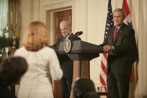 President George W. Bush and Prime Minister Ibrahim Jaafari listen to a question from the media Friday, June 24, 2005, during a press availability in the East Room of the White House. White House photo by Eric Draper