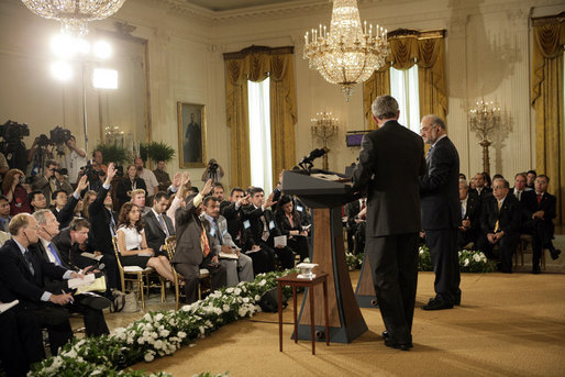 Members of the media raise their hands to President George W. Bush and Iraqi Prime Minister Ibrahim Jaafari during a media availability Friday, June 24. 2005, in the East Room of the White House. White House photo by Eric Draper