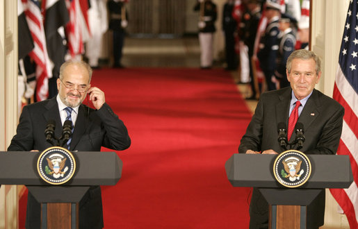President George W. Bush and Dr. Ibrahim Jaafari, Prime Minister of Iraq, take questions from the media during a joint press conference Friday, June 24, 2005, in the East Room of the White House. White House photo by Paul Morse