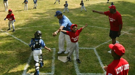 "Everyone's on the move as the Memphis Red Sox from Chicago score against the Black Yankees of Newark during ""Tee Ball on the South Lawn"" Sunday, June 26, 2005. White House photo by Paul Morse"