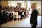 President George W. Bush greets the 2005 Presidential Scholars during a group photo shoot in the East Room June 27, 2005. Chosen from more than 2,700 high school candidates, 141 scholars are honored for their accomplishments in academics and the arts. White House photo by Eric Draper