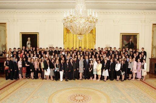 President George W. Bush and Secretary of Education Margaret Spellings stand with the 2005 Presidential Scholars in the East Room June 27, 2005. Chosen from more than 2,700 high school candidates, 141 scholars are honored for their accomplishments in academics and the arts. White House photo by Krisanne Johnson