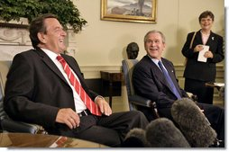 President George W. Bush and German Chancellor Gerhard Schroeder talk with the media in the Oval Office Monday, June 27, 2005.  White House photo by Eric Draper