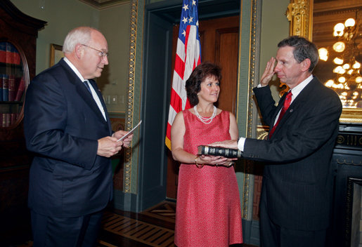 Vice President Dick Cheney swears in NASA Administrator Michael Griffin as his wife, Rebecca Griffin, holds the Bible during a ceremony in the Vice President's Ceremonial Office at the Dwight D. Eisenhower Executive Office Building Tuesday, June 28, 2005. Mr. Griffin is the 11th Administrator of the National Aeronautics and Space Administration. White House photo by David Bohrer
