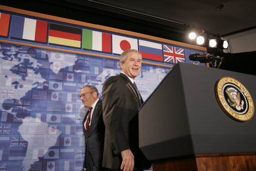 President George W. Bush stands at the podium after being introduced at the Freer Gallery in Washington D.C., Thursday, June 30, 2005, by Walter Stern, Chairman of the Board of Trustees, the Hudson Institute. The President spoke about his participation in the upcoming G8 Summit in Scotland, highlighting new initiatives to improve the quality of life of sub-Saharan Africans. White House photo by Paul Morse