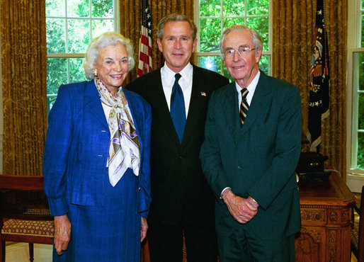 President George W. Bush stands with Supreme Court Justice Sandra Day O'Connor and her husband, John O'Connor, May 2004 in the Oval Office. Justice O'Connor submitted her resignation to the President Friday, July 1, 2005, after 24 years on the High Court to spend more time with her husband. File Photo. White House photo by Eric Draper