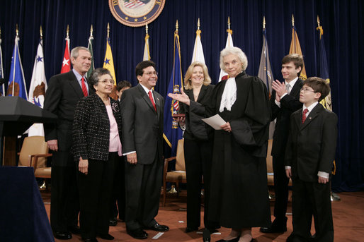 Justice Sandra Day O'Connor introduces Alberto Gonzalez to the audience after administering the oath of office to him during ceremonies welcoming him to his new post of U.S. Attorney General. Justice O'Connor submitted her resignation to President George W. Bush Friday, July 1, 2005, to spend more time with her husband, John O'Connor. File photo. White House photo by Paul Morse