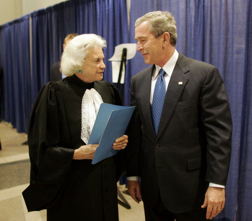 President George W. Bush and Supreme Court Justice Sandra Day O'Connor share a moment backstage March 3, 2005, prior to the swearing-in ceremonies for Michael Chertoff as secretary of Homeland Security. In response to the Justice's resignation, President Bush called her one of the most admired women of her time and said he was proud to know her. File photo. White House photo by Paul Morse