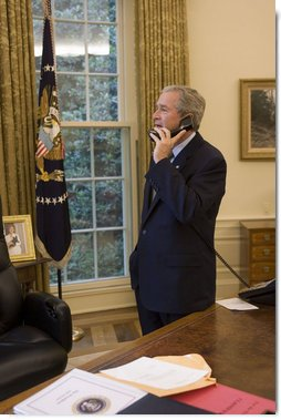 President George W. Bush speaks via phone to Associate Supreme Court Justice Sandra Day O'Connor Friday, July 1, 2005, shortly after she submitted her letter of resignation citing personal reasons. The letter sits on the desk. White House photo by Paul Morse
