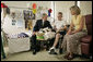President George W. Bush talks with U.S. Army Specialist Nicholas Beintema and his mother Stacy Beintema of Woodbridge, Calif., while visiting wounded troops at Walter Reed Army Medical Hospital Friday, July 1, 2005. Spc. Beintema was wounded while serving in Operation Iraqi Freedom. White House photo by Eric Draper