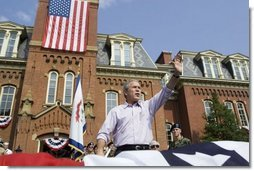 "President George W. Bush waves to the estimated 3,000 people in attendance at an Independence Day celebration Monday, July 4, 2005, at West Virginia University in Morgantown. Said the President, ""The history we celebrate today is a testament to the power of freedom to lift up a whole nation.""  White House photo by Krisanne Johnson"