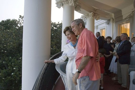 "On July 4, 2005, President and Mrs. Bush listen as a South Lawn crowd sings ""Happy Birthday"" at the White House in celebration of the President's upcoming birthday on July 6. White House photo by Krisanne Johnson"