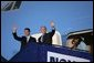President George W. Bush and Prime Minister Anders Fogh Rasmussen wave from Air Force One upon the President's arrival to Kastrup, Denmark, Tuesday, July 5, 2005. White House photo by Krisanne Johnson
