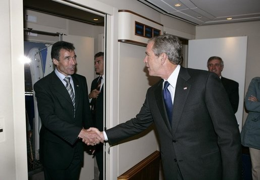 President George W. Bush welcomes Prime Minister Anders Fogh Rasmussen aboard Air Force One after arriving in Kastrup, Denmark, Tuesday, July 5, 2005. White House photo by Eric Draper