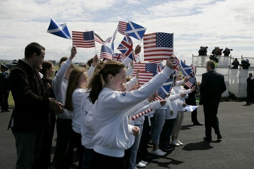 President George W. Bush and Laura Bush are greeted by ceremony and cheers upon their arrival at Glasgow Prestwick International Airport in Scotland July 6, 2005. White House photo by Krisanne Johnson