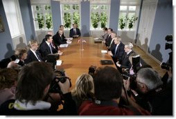 President George W. Bush meets with Danish Prime Minister Anders Fogh Rasmussen, center, left, at his summer residence in Marienborg in Kongens Lyngby, Denmark, Wednesday, July 6, 2005. White House photo by Eric Draper