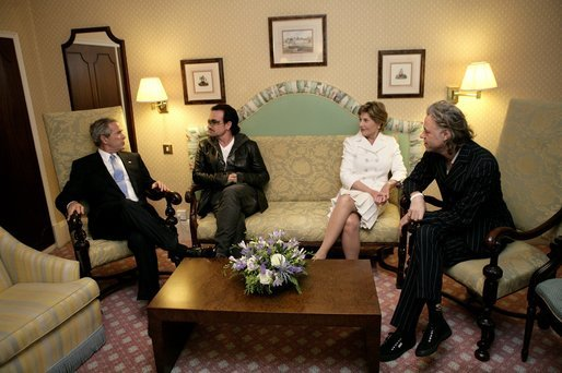 President George W. Bush, Bono, Laura Bush and Bob Geldof, far right, hold a working meeting on Africa at the G8 Summit in Gleneagles, Scotland, Wednesday, July 6, 2005. White House photo by Eric Draper