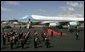 As President George W. Bush and Laura Bush disembarks Air Force One, a band is poised for their arrival at Glasgow's Prestiwick Airport, July 6, 2005. White House photo by Paul Morse