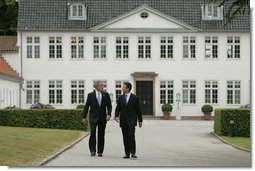 President George W. Bush is greeted by Danish Prime Minister Anders Fogh Rasmussen at his summer residence in Marienborg in Kongens Lyngby, Denmark, Wednesday, July 6, 2005. White House photo by Paul Morse