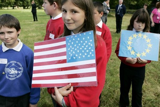 Children carrying US flags welcome Mrs. Bush and other spouses to the Spouses Program, hosted by Mrs. Cherie Blair, wife of Prime Minister Tony Blair of England, during the G8 Summit in Scotland Thursday, July 7, 2005. White House photo by Krisanne Johnson