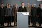President George W. Bush and fellow G8 leaders stand behind England's Prime Minister Tony Blair Thursday, July 7, 2005, as he addressed the media at the Gleneagles Hotel in Auchterarder, Scotland, regarding the terrorist attacks that occured in London earlier in the day. White House photo by Eric Draper